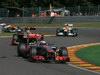 GP BELGIO, 02.09.2012- Gara, Jenson Button (GBR) McLaren Mercedes MP4-27 davanti a Kimi Raikkonen (FIN) Lotus F1 Team E20