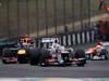 GP BRASILE, 25.11.2012- Gara, Kamui Kobayashi (JAP) Sauber F1 Team C31 davanti aSebastian Vettel (GER) Red Bull Racing RB8