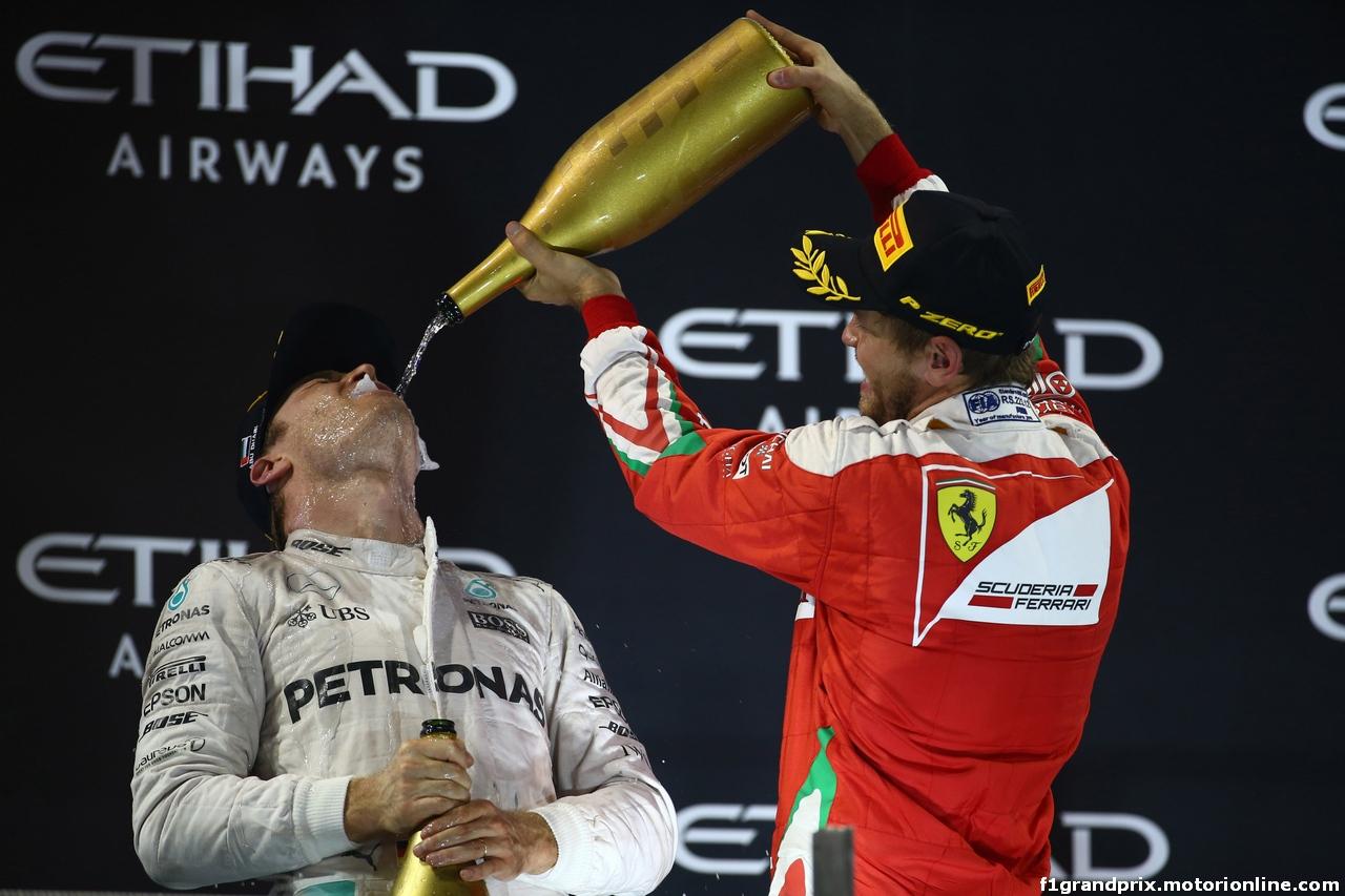 GP ABU DHABI, 27.11.2016 - Gara, 2nd place Nico Rosberg (GER) Mercedes AMG F1 W07 Hybrid e Champion 2016 e 3rd place Sebastian Vettel (GER) Ferrari SF16-H
