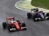 GP BRASILE, 13.11.2016 - Gara, Sebastian Vettel (GER) Ferrari SF16-H e Felipe Nasr (BRA) Sauber C34