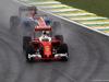 GP BRASILE, 13.11.2016 - Gara, Sebastian Vettel (GER) Ferrari SF16-H e Pascal Wehrlein (GER) Manor Racing MRT05