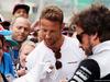GP GRAN BRETAGNA, 07.07.2016- (L to R): Jenson Button (GBR) McLaren e team mate Fernando Alonso (ESP) McLaren sign autographs for the fans.