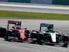 GP MALESIA, 02.10.2016 - Gara, Kimi Raikkonen (FIN) Ferrari SF16-H e Nico Rosberg (GER) Mercedes AMG F1 W07 Hybrid