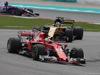 GP MALESIA, 01.10.2017 - Gara, Sebastian Vettel (GER) Ferrari SF70H e Nico Hulkenberg (GER) Renault Sport F1 Team RS17