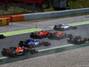 GP SPAGNA, Max Verstappen (NLD) Red Bull Racing RB13 e Kimi Raikkonen (FIN) Ferrari SF70H return to the circuit after running wide at the partenza of the race. 14.05.2017.