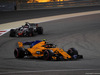 GP BAHRAIN, 08.04.2018 - Gara, Stoffel Vandoorne (BEL) McLaren MCL33 davanti a Romain Grosjean (FRA) Haas F1 Team VF-18