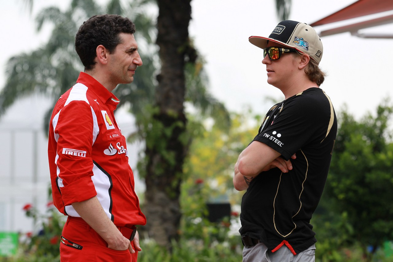 22.03.2012- Andrea Stella (ITA) Ferrari Race Engineer and Kimi Raikkonen (FIN) Lotus F1 Team E20