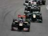 GP BRASILE, 27.11.2011- Gara, Jaime Alguersuari (SPA), Scuderia Toro Rosso, STR6 e Heikki Kovalainen (FIN), Team Lotus, TL11