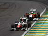 GP BRASILE, 27.11.2011- Gara, Vitantonio Liuzzi (ITA), HRT Formula One Team e Paul di Resta (GBR) Force India VJM04