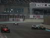 GP ABU DHABI, Gara: Sebastian Vettel (GER) Red Bull Racing RB8 overtakes Romain Grosjean (FRA) Lotus F1 Team E20