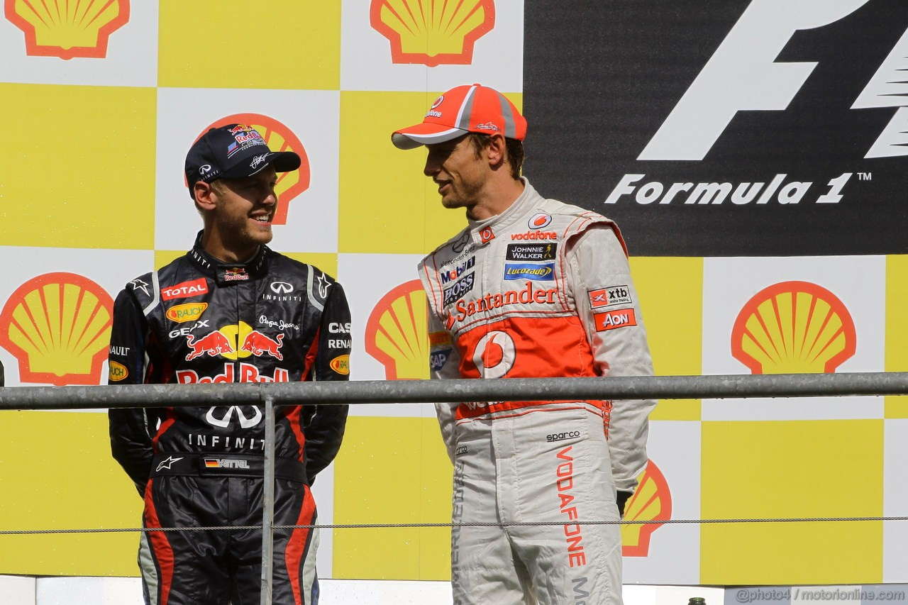 GP BELGIO, 02.09.2012- Gara, secondo Sebastian Vettel (GER) Red Bull Racing RB8 e Jenson Button (GBR) McLaren Mercedes MP4-27 vincitore