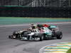 GP BRASILE, 25.11.2012- Gara, Kimi Raikkonen (FIN) Lotus F1 Team E20 e Michael Schumacher (GER) Mercedes AMG F1 W03
