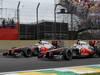 GP BRASILE, 25.11.2012- Gara, Jenson Button (GBR) McLaren Mercedes MP4-27 e Lewis Hamilton (GBR) McLaren Mercedes MP4-27