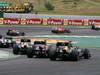 GP BRASILE, 25.11.2012- Gara, Mark Webber (AUS) Red Bull Racing RB8 e Heikki Kovalainen (FIN) Caterham F1 Team CT01