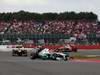 GP GRAN BRETAGNA, 08.07.2012- Gara, Michael Schumacher (GER) Mercedes AMG F1 W03 davanti a Kimi Raikkonen (FIN) Lotus F1 Team E20