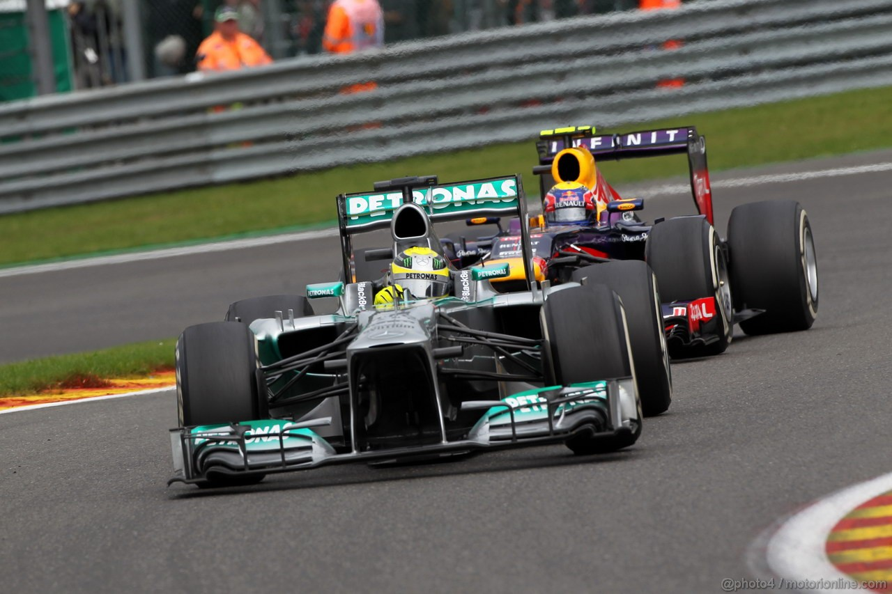 GP BELGIO, 25.08.2013-  Gara, Nico Rosberg (GER) Mercedes AMG F1 W04 e Mark Webber (AUS) Red Bull Racing RB9