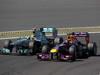 GP GERMANIA, 07.07.2013-  Gara, Sebastian Vettel (GER) Red Bull Racing RB9 pass Lewis Hamilton (GBR) Mercedes AMG F1 W04