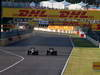 GP GIAPPONE, 13.10.2013- Gara, Sebastian Vettel (GER) Red Bull Racing RB9 overtakes Romain Grosjean (FRA) Lotus F1 Team E21