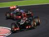 GP GIAPPONE, 13.10.2013- Gara, Kimi Raikkonen (FIN) Lotus F1 Team E21 davanti a Jenson Button (GBR) McLaren Mercedes MP4-28