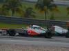 GP MALESIA, 24.03.2013- Gara, Jenson Button (GBR) McLaren Mercedes MP4-28 overtaking Nico Rosberg (GER) Mercedes AMG F1 W04