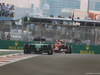 GP ABU DHABI, 23.11.2014- Gara, Kamui Kobayashi (JAP) Caterham F1 Team CT-04 davanti a Kimi Raikkonen (FIN) Ferrari F14-T
