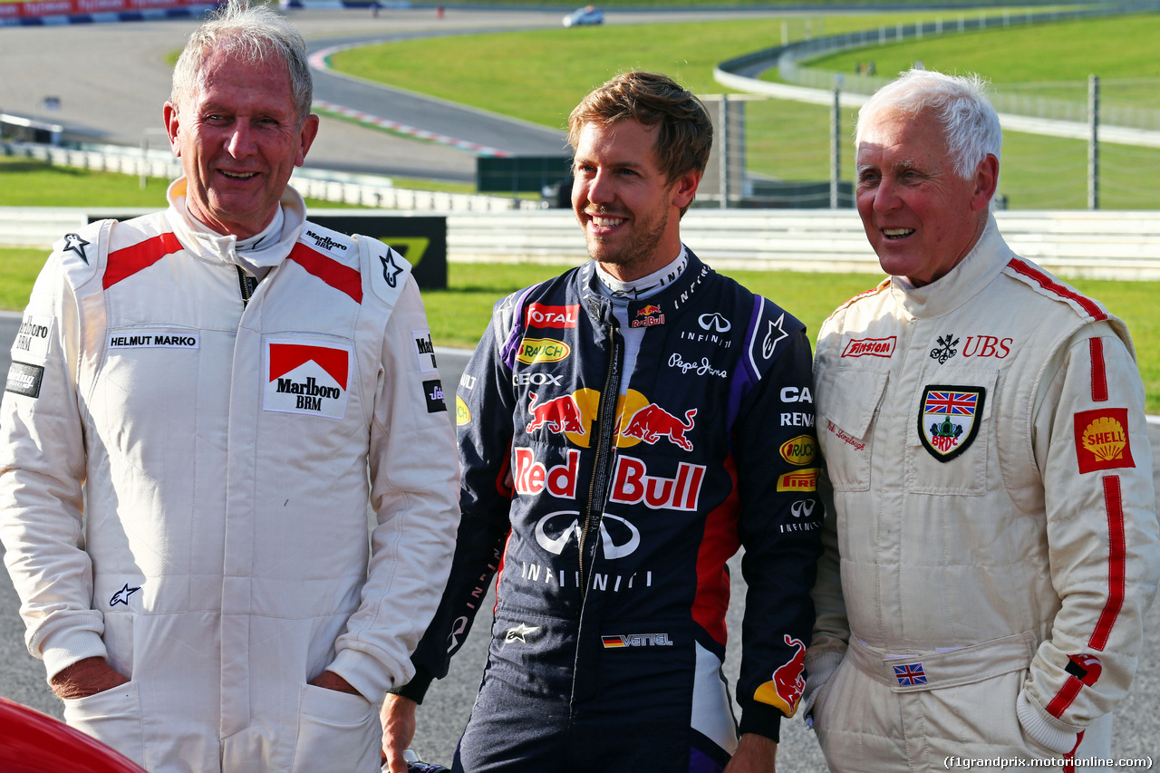 GP AUSTRIA, 21.06.2014- (L to R): Dr Helmut Marko (AUT) Red Bull Motorsport Consultant with Sebastian Vettel (GER) Red Bull Racing.