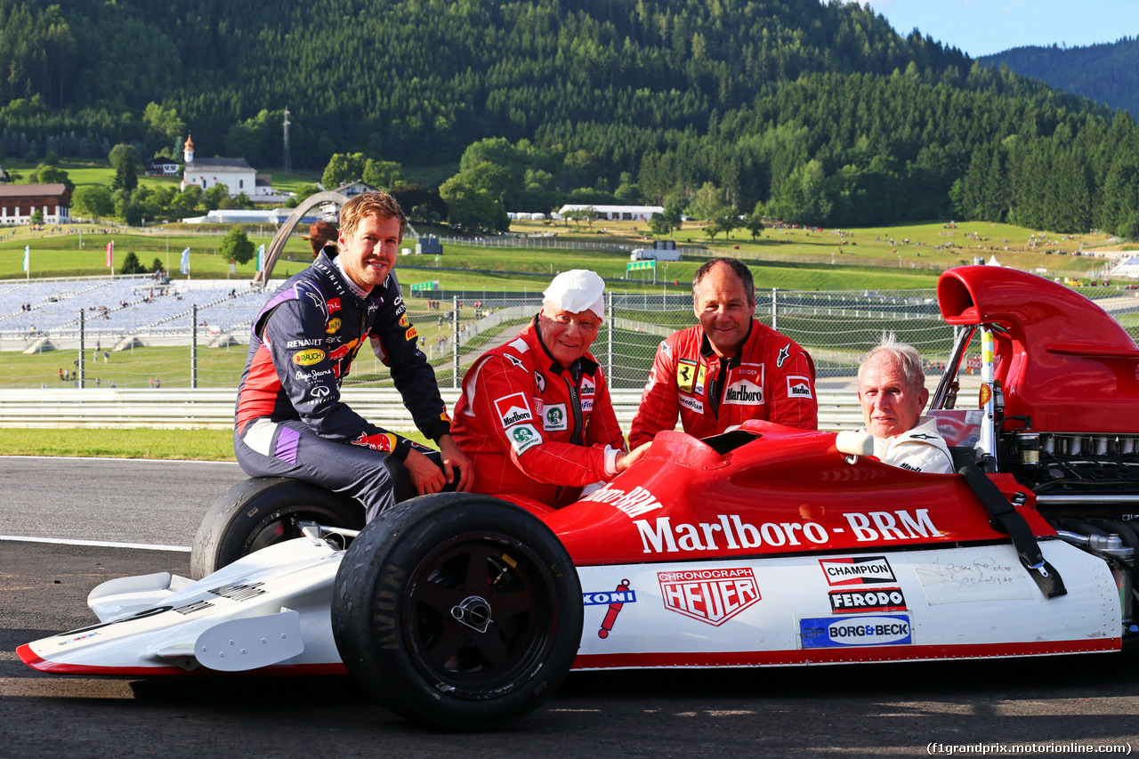 GP AUSTRIA, 21.06.2014- Dr Helmut Marko (AUT) Red Bull Motorsport Consultant, sitting in his old BRM P160, with (L to R): Sebastian Vettel (GER) Red Bull Racing; Niki Lauda (AUT) Mercedes Non-Executive Chairman; e Gerhard Berger (AUT).