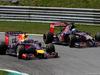 GP AUSTRIA, 22.06.2014- Gara, Sebastian Vettel (GER) Red Bull Racing RB10 e Jean-Eric Vergne (FRA) Scuderia Toro Rosso STR9