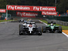 GP BELGIO, 24.08.2014- Gara, Jenson Button (GBR) McLaren Mercedes MP4-29 e Andre Lotterer (GER), Caterham F1 Team
