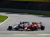 GP BELGIO, 24.08.2014- Gara, Kimi Raikkonen (FIN) Ferrari F14-T e Jenson Button (GBR) McLaren Mercedes MP4-29