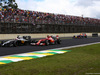 GP BRASILE, 09.11.2014 - Gara, Kimi Raikkonen (FIN) Ferrari F14-T e Jenson Button (GBR) McLaren Mercedes MP4-29