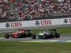 GP GERMANIA, 20.07.2014- Gara, the fight btween Kimi Raikkonen (FIN) Ferrari F14T e Lewis Hamilton (GBR) Mercedes AMG F1 W05