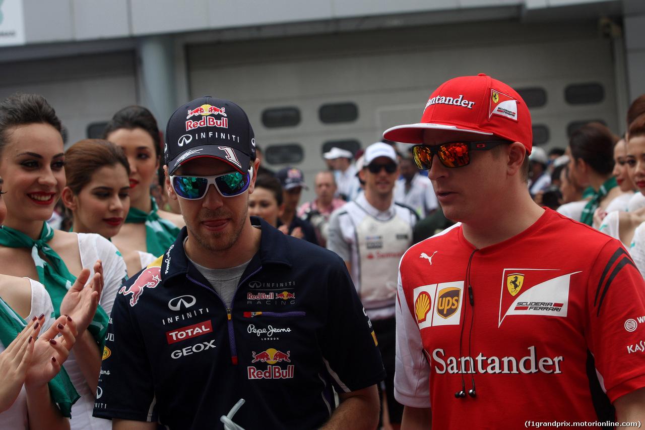 GP MALESIA, 30.03.2014 - Sebastian Vettel (GER) Red Bull Racing RB10 e Kimi Raikkonen (FIN) Ferrari F14-T at drivers parade