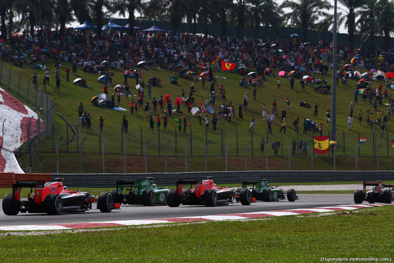 GP MALESIA, 30.03.2014 - Gara, Start of the race, Marcus Ericsson (SUE) Caterham F1 Team CT-04 e Jules Bianchi (FRA) Marussia F1 Team MR03