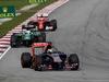 GP MALESIA, 30.03.2014 - Gara, Jean-Eric Vergne (FRA) Scuderia Toro Rosso STR9 davanti a Marcus Ericsson (SUE) Caterham F1 Team CT-04
