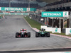 GP MALESIA, 30.03.2014 - Gara,Romain Grosjean (FRA) Lotus F1 Team E22 e Kamui Kobayashi (JAP) Caterham F1 Team CT-04