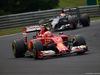 GP UNGHERIA, 27.07.2014- Gara, Kimi Raikkonen (FIN) Ferrari F14-T davanti a Adrian Sutil (GER) Sauber F1 Team C33
