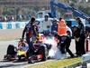 TEST F1 JEREZ 30 GENNAIO, Daniel Ricciardo (AUS) Red Bull Racing RB10 stops on the circiuit e extinguisher is applied to the car. 30.01.2014. Formula One Testing, Day Three, Jerez, Spain.