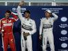 GP BAHRAIN, 18.04.2015 - Qualifiche, Lewis Hamilton (GBR) Mercedes AMG F1 W06 pole position, secondo Sebastian Vettel (GER) Ferrari SF15-T e terzo Nico Rosberg (GER) Mercedes AMG F1 W06