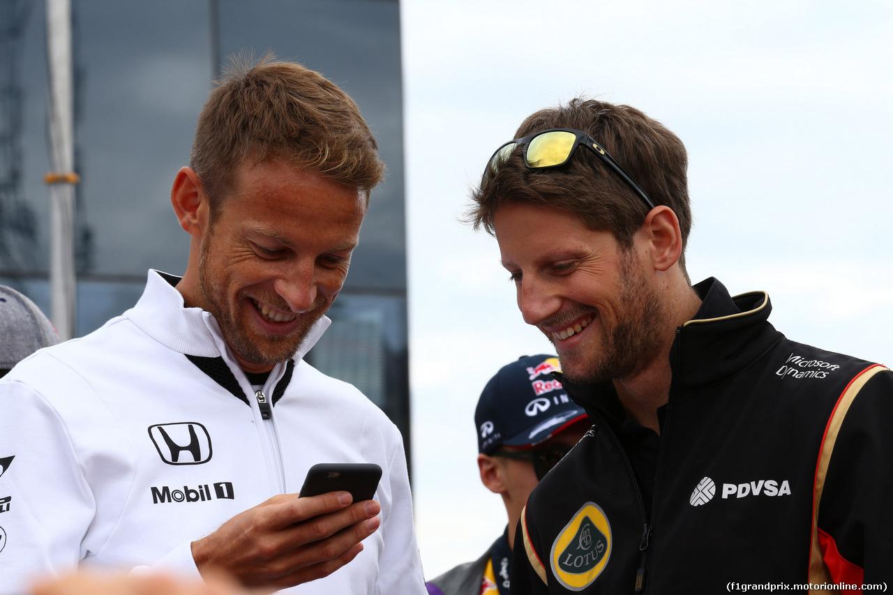 GP UNGHERIA, 26.07.2015 - Jenson Button (GBR)  McLaren Honda MP4-30. e Romain Grosjean (FRA) Lotus F1 Team E23