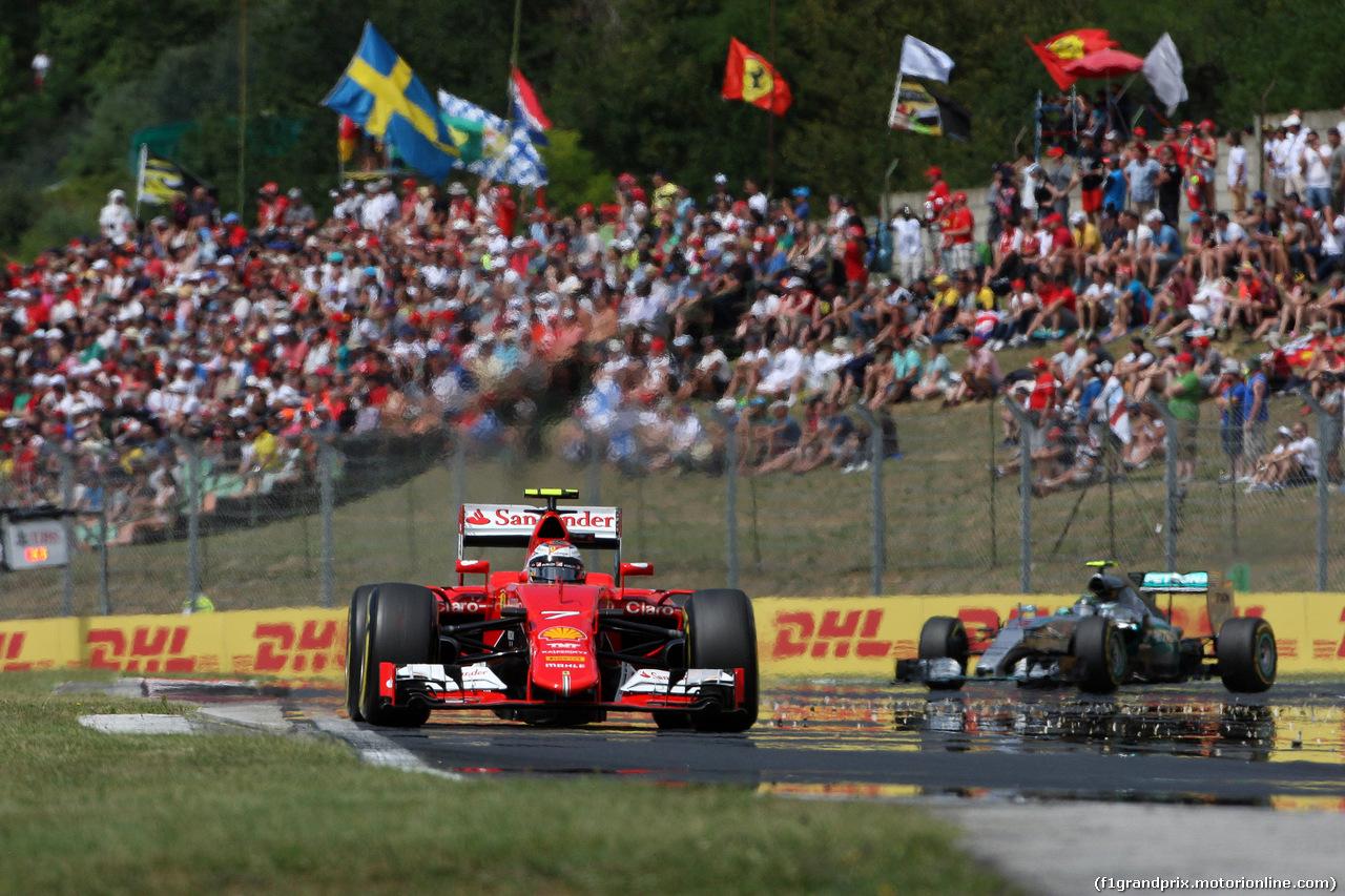 GP UNGHERIA, 26.07.2015 - Gara, Kimi Raikkonen (FIN) Ferrari SF15-T e Nico Rosberg (GER) Mercedes AMG F1 W06