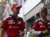GP SINGAPORE, 18.09.2016 - Sebastian Vettel (GER) Ferrari SF16-H e Britta Roeske (AUT) Ferrari Press Officer.