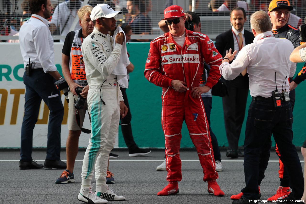 GP MALESIA, 30.09.2017 - Qualifiche, Lewis Hamilton (GBR) Mercedes AMG F1 W08 pole position e Kimi Raikkonen (FIN) Ferrari SF70H 2nd place