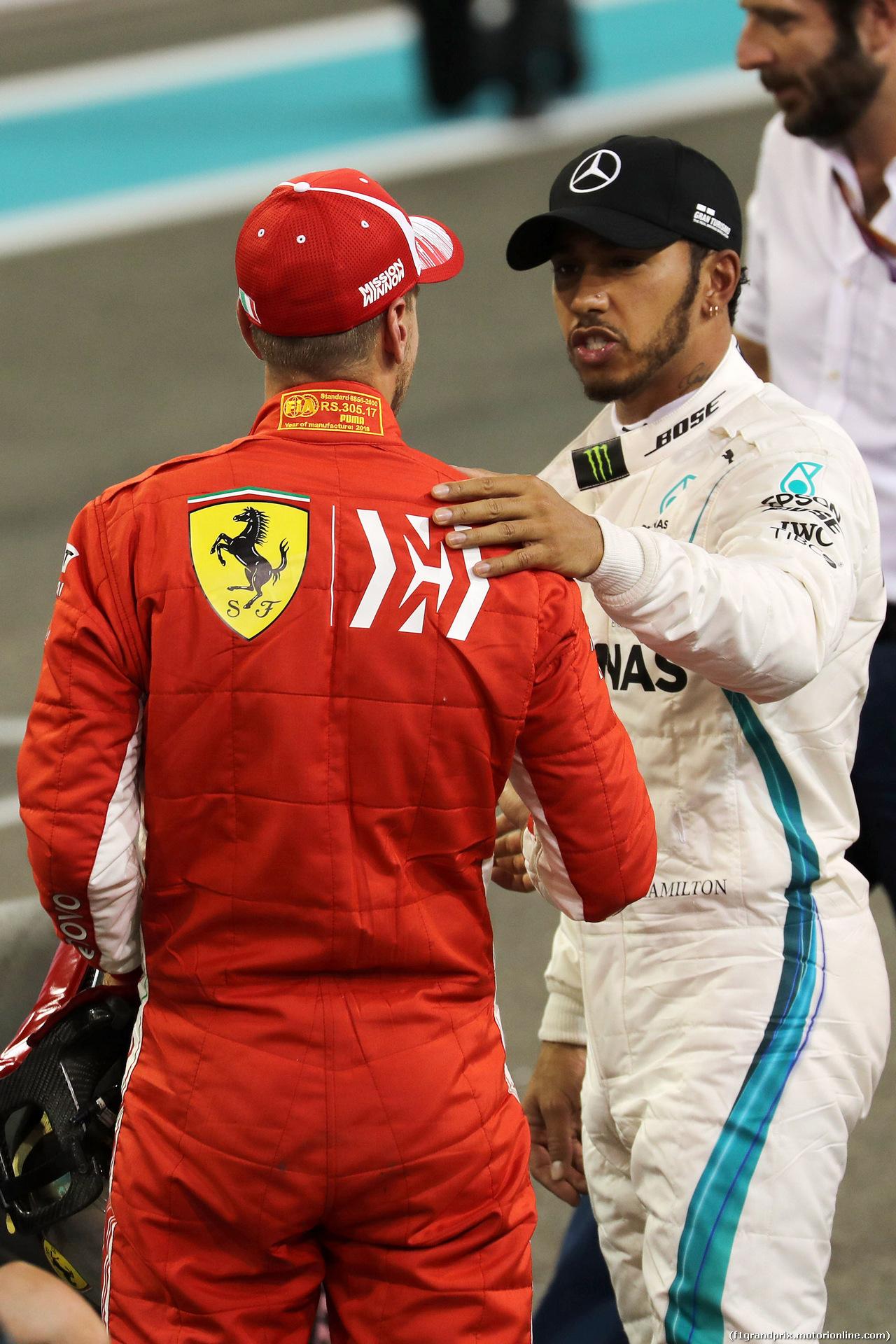 GP ABU DHABI, 24.11.2018 - Qualifiche, 3rd place Sebastian Vettel (GER) Ferrari SF71H e Lewis Hamilton (GBR) Mercedes AMG F1 W09 pole position