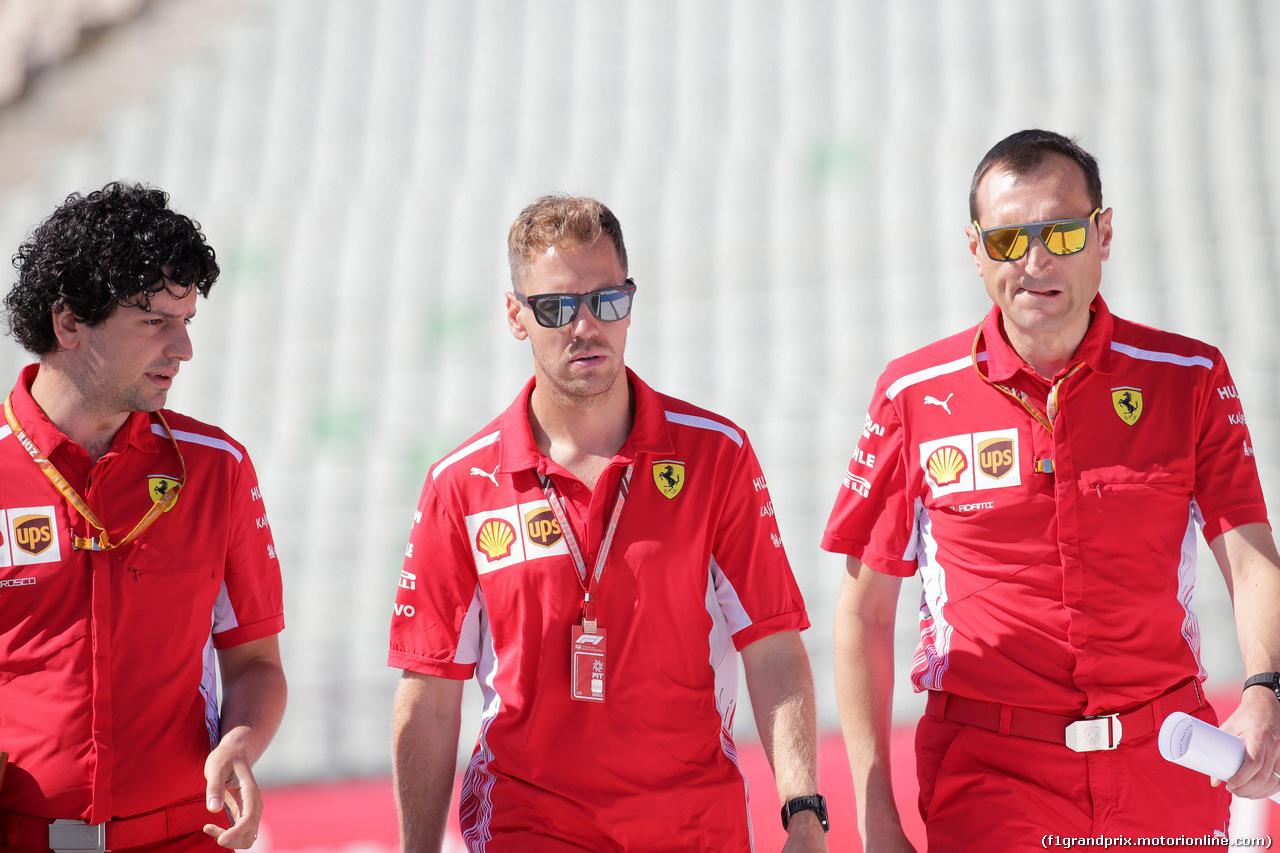 GP GERMANIA, 19.07.2018 - Edoardo Brosco (ITA) Ferrari F1 – Track Engineer, Sebastian Vettel (GER) Ferrari SF71H e Riccardo Adami (ITA) Ferrari Gara Engineer