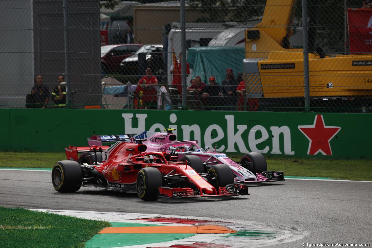 GP ITALIA, 02.09.2018 - Gara, Sebastian Vettel (GER) Ferrari SF71H e Esteban Ocon (FRA) Racing Point Force India F1 VJM11