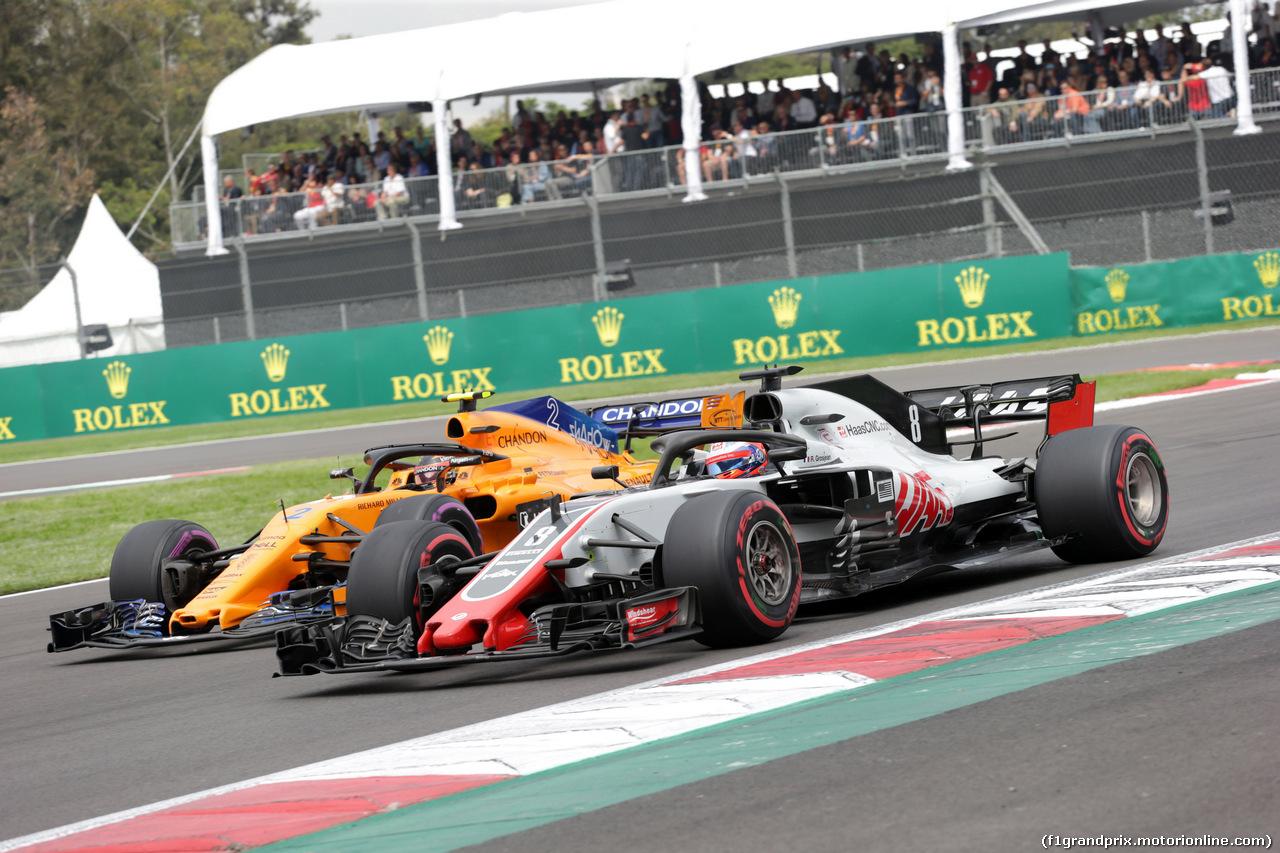 GP MESSICO, 28.10.2018 - Gara, Stoffel Vandoorne (BEL) McLaren MCL33 e Romain Grosjean (FRA) Haas F1 Team VF-18