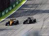 GP BRASILE, 17.11.2019 - Gara, Lando Norris (GBR) Mclaren F1 Team MCL34 e Romain Grosjean (FRA) Haas F1 Team VF-19