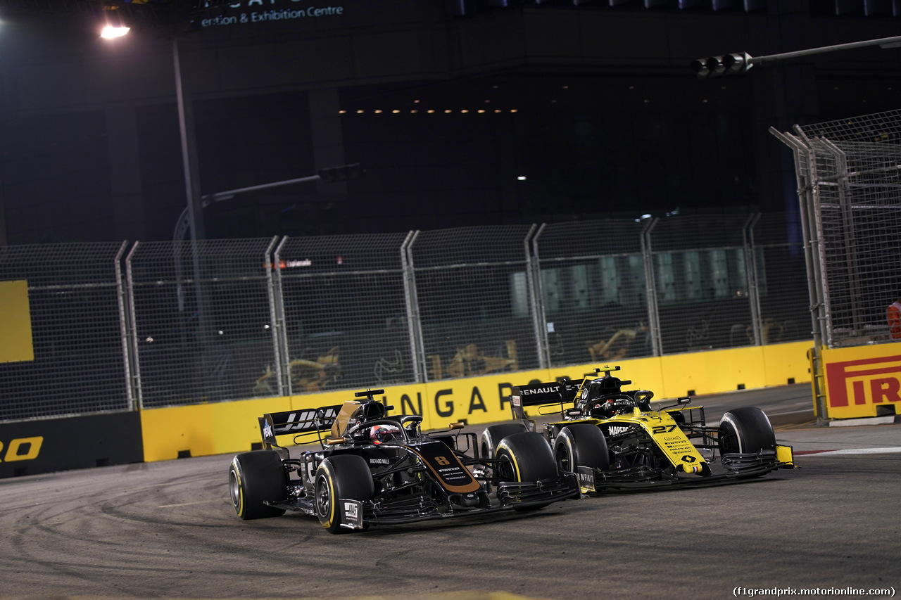 GP SINGAPORE, 22.09.2019 - Gara, Romain Grosjean (FRA) Haas F1 Team VF-19 e Nico Hulkenberg (GER) Renault Sport F1 Team RS19