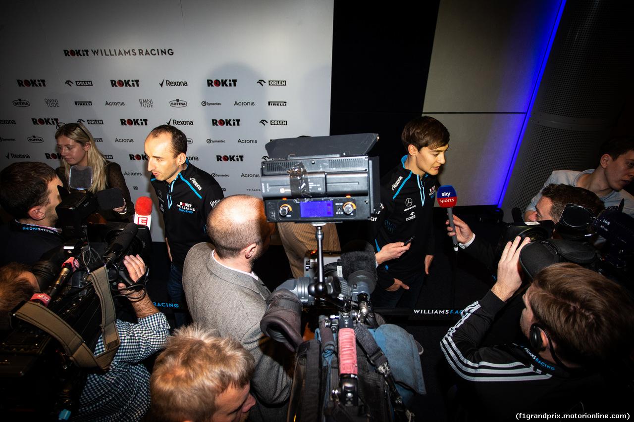 WILLIAMS LIVREA ROCKIT, (L to R): Robert Kubica (POL) Williams Racing e team mate George Russell (GBR) Williams Racing with the media. 11.02.2019.
